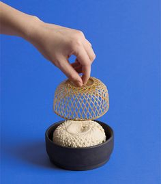 Hand-woven baskets and ceramic bowls slot into this portable tofu making kit