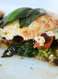 STACKED CHICKEN BAKE (eggplant, broccoli rabe, tomato & chicken & mozzarella)