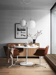 a Japanese-styled sideboard and some mid-century chairs upholstered with cognac leather