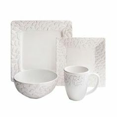 "Offering charming appeal for your dining room table, this lovely earthenware dinnerware set features raised scrolling details.   Product: 4 Dinner plates4 Salad plates4 Bowls4 MugsConstruction Material: Earthenware Color: WhiteDimensions: 14"" W x 14"" D (dinner plate)"