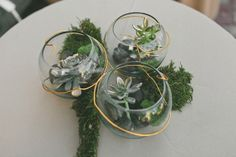 Rent three smaller vases to create a bigger wedding centerpiece