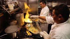 Image: Chefs cook at Zazie, a San Francisco restaurant that provides every member of the staff with full benefits, including a 401(k).