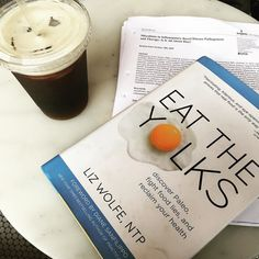 Favorite thing about rainy days? Sitting in a #Brooklyn cafe sipping Smith Canteen's incredible cold brew & reading up on #ASPEN's latest research on a low FODMAP diet for #IBS & #IBD... And a little lighthearted nutrition reading for when I need a break from the hardcore science. #EatTheYolks touts a paleo framework but even for those of us who aren't #paleo but instead try to choose foods from real wholesome #nutrientdense sources @realfoodliz does an amazing job of elucidating some of the…