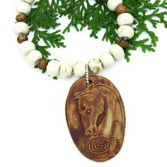 The one of a kind, handmade Spirit Horse necklace features an artisan created horse head and spiral ceramic pendant, faceted magnesite, picture jasper and sterling silver  - beautiful jewelry for the woman who loves horses.