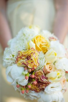 Warm plum and coral colors accented the yellow palette
