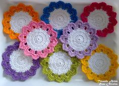 simple flower-shaped crochet coasters with contrast petals