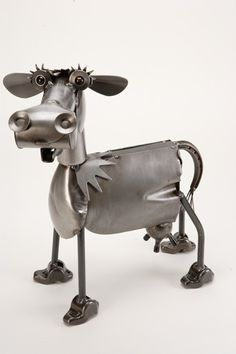 Metal Cow Sculpture. Very unique with a creative design this cow sculpture is made from spare metal scrap parts a wonderful piece for a patio or porch area. Handmade here in the USA