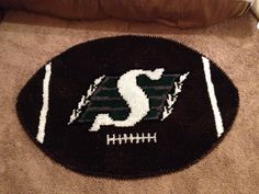A Saskatchewan Roughriders carpet made for me by a friend! Go Rider, Saskatchewan Roughriders, Whimsical, Pride, Crochet Patterns, Cross Stitch, Carpet, Party Ideas, Football