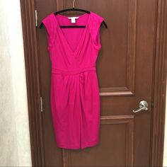 """DVF Fuchsia Wool V-Neck Dress Size 6 This dress runs small. Hugs your curves and accentuates all the right thing! The draping in the front is forgiving, but the v-neck makes this a sexy date night or event dress! Absolutely stunning on! Dress falls just below the knee on someone 5'7"""" Diane von Furstenberg Dresses Midi"""
