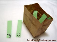 Wiggle Worm- Whole Group Game. Strips of green paper in a bag. On some of the strips is a worm, on others a heart, etc. Pass the bag around the circle, & pull out a strip. When its a worm, they wiggle and move around. When its a heart, you give a hug/high five to a neighbor. You could put any symbol/action on there you want. Great for developing self-control, and cooperative play.