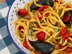 Spaghetti with Clams:  Mussels, and Tomatoes - Remarkably scrumptious, olive oil, garlic, dry white wine, mussels, clams, long pasta, cherry tomatoes, crushed red pepper flakes, black pepper, fresh parsley leaves