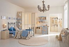 Wow. Great subtlety in use of color. Pretty light cornflower blue and ivory bedroom, with a brighter white floor.