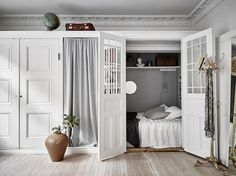 A bed in a cupboard / alcove...in a Swedish apartment.