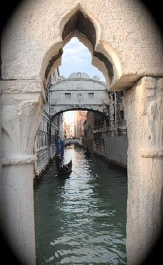Bridge of Sighs  Prisoners would  cross the bridge look outside it would be their last view of the outside  world before going to their cells in the basement never to see the light of day again.  That is why it's called the bridge of sighs