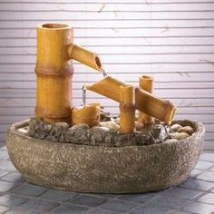 Did you know that you can make tabletop fountains out of bamboo? Bamboo is one of the most popular materials during this green-friendly new era. It is tech Indoor Wall Fountains, Indoor Fountain, Garden Fountains, Water Fountains, Fountain Ideas, Bamboo Water Fountain, Tabletop Water Fountain, Indoor Waterfall Wall, Indoor Bamboo