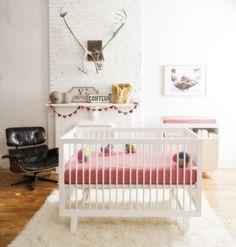 Baby room set up white carpet of black Chair white brick wall