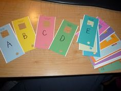 Clever letter finders made from paint chips. Go on a hunt to find alphabet letters around the room. Or use to match upper and lowercase letters Literacy Work Stations, Math Centers, Reading Centers, Learning Stations, Reading Workshop, Literacy Activities, Full Day Kindergarten, Kindergarten Literacy, Early Literacy