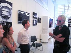 """World famous artist Cheyco Leidmann at the """"Symmetry of Demolition"""" Exhibit. You can see this exhibit in the Art Deco Museum. The exhibit will be up until December so stop by and visit today! #MiamiBeach #MDPLEvents #CheycoLeidman #SymmetryofDemolition"""