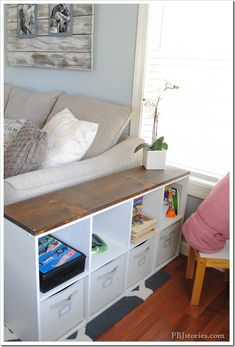Extra Storage Side Table/ Behind the couch table. use the storage cubes for hiding toys, magazines, randoms Extra Storage Side Table/ Behind the couch table. use the storage cubes for… Living Room Storage, Living Room Sofa, Entryway Storage, Living Rooms, Ikea Expedit Shelf, Ikea Cubes, Cube Storage, Extra Storage, Storage Units