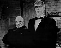 Great Group Halloween Costumes: The Addams Family - Publicity photo of Jackie Coogan (Uncle Fester) and Ted Cassidy (Lurch) from a personal appearance booking at Pleasure Island (Massachusetts amusement park, Wakefield Massachusetts). Lurch Addams Family, The Addams Family 1964, Addams Family Tv Show, Addams Family Costumes, Family Tv Series, Adams Family, Group Halloween Costumes, Halloween Party, Halloween Ideas