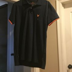Brand new with tags. American Eagle men's small Brand new with tags American Eagle classic fit men's shirt. size small.  It is navy blue and has orange trim on collar and sleeves American Eagle Outfitters Tops