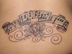 Lotus flower tattoo with musical notes