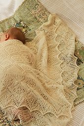 This delicate lace shawl is perfect for Christenings, and will be treasured for generations.