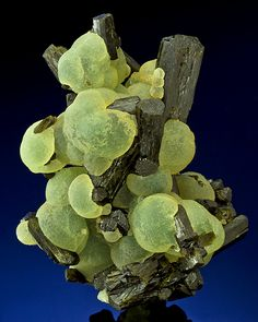 Prehnite balls intermingled with Schorl Tourmaline. From the Djouga diggings, Bendougou Village, Arrondissement Diako, Bafoulabé Circle, Kayes Region, Mali. Measures 9.5 cm by 7.3 cm by 4.7 cm in total size. Ex. J. Webb Mineral Collection /  Mineral Friends