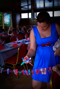 Baby Shower Game - Holding a baby take as many pegs off the line with your free hand without dropping any