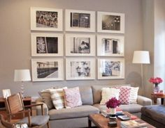 Check out this beautiful arrangement in a modern living room!  www.customframedesigns.com  #gallery #wall #picture #frames by Wendy Davis Custom Framing