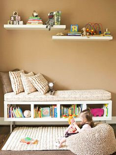 Open-backed bookcase, turned sideways. Paint and attach feet. Top with a cozy layer of pillows.
