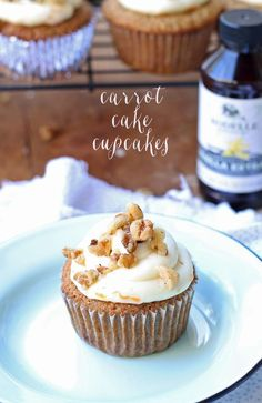 Delicious carrot cake cupcakes, filled and topped with delicious cream cheese frosting! @rodellevanilla #rodellevanilla #madewithrodelle