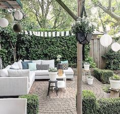 Backyard sectional seating area with circular paver patio. Ivy growing on fence and box hedge providing seclusion Outdoor Areas, Outdoor Rooms, Outdoor Living, Outdoor Decor, Terrasse Design, Garden Design, Landscape Design, Backyard Lighting, Brick Patios