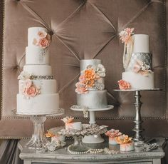 trio of peach pink wedding cakes with silver