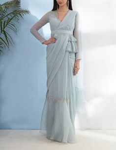 Peplum Blouse with Ruffled Saree And Embellished Belt Indian Fashion Dresses, Dress Indian Style, Indian Designer Outfits, Indian Fashion Trends, Fashion Brands, Stylish Blouse Design, Fancy Blouse Designs, Saree Blouse Designs, Lehenga Designs