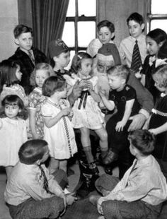 Vintage Christmas Photo ~ Depression era children gather around to tell Santa Claus what they wish for.