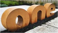 Garden art with corten steel. Pierre Le Roux Designs are adding design to outdoor accessories. Exterior Gray Paint, Exterior House Siding, Exterior Signage, Exterior Front Doors, Exterior House Colors, Exterior Design, Environmental Graphic Design, Environmental Graphics, Wayfinding Signage