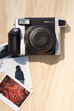 WHAT I WANT THE MOSTTTT. THIS MODEL IS DA BESTTT. Fujifilm Instax 210 Wide Format Instant Camera - Urban Outfitters