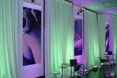 White Sheer event drape is an excellent backdrop to absorb up lit color.