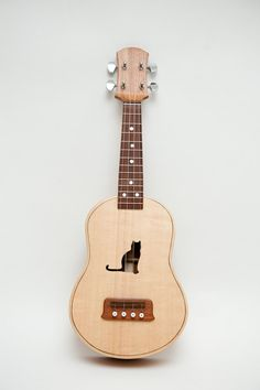 Concert ukulele (customizable sound hole of choice) Example: Cat. $400.00, via Etsy.