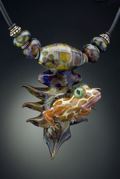 Sculpted glass frog bead necklace by Wayne Robbins and Judie Mountain...www.mountainrobbins.com