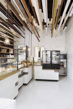 Inviting Bakery Design in Warsaw Exhibiting an Eye-Catching Plywood Installation - http://www.interiordesign2014.com/interior-design-ideas/inviting-bakery-design-in-warsaw-exhibiting-an-eye-catching-plywood-installation/