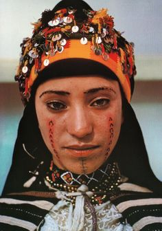 Moroccan Amazigh Berber woman with facial tattoo in traditional dress and jewelry. Ait Hdidou, Atlas, Kahenas
