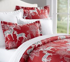 Would be great to add a bold pop of color to our bedroom in the winter. Santa's Reindeer Organic Duvet & Sham | Pottery Barn