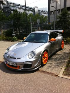 with orange wheels Porsche 911 GT3 RS 4.0 the orange wheels work well with silver body http://extreme-modified.com/