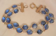 Beautiful Sapphire color crystal double strand Bracelet is in very good Circa sixty's condition. Features two attached rows of gorgeous beveled