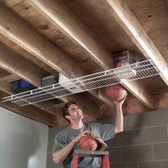 Under-Joist Shelf The unused space between overhead joists in a basement or garage is a brilliant place to install a heavy-duty wire shelf. Workshop Storage, Bike Storage, Shed Storage, Tool Storage, Garage Storage, Outdoor Storage, Easy Storage, Pegboard Storage, Extra Storage