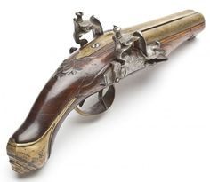"""Circa 1730-1750 DESIGN: Double barreled flintlock pistol with 4"""" brass barrels. Double triggers. Bores measure approximately .40"""". A fine example of an early 18th century pistol, most likely French, with rare and fine detailing."""