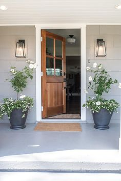 Episode 07 - The Baker House - Magnolia Market Do you love the Baker home in episode 5 as much as we do? View images of each room, including the bright, airy kitchen with open shelving. Front Door Lighting, Wood Front Doors, Porch Lighting, Exterior Lighting, Front Porch Lights, White Trim Wood Doors, Outside Lights On House, Grey House White Trim, Patio Doors