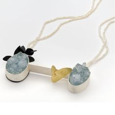 """""""My Fight of Frost"""" necklaceis made from 18kt yellow gold, silver, iron, quartz, andpearls."""